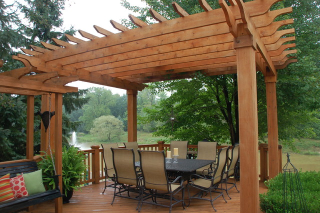 Hedge Landscape, Bluestone Patio, Fireplace, Pergola And Arbor Traditional  Patio