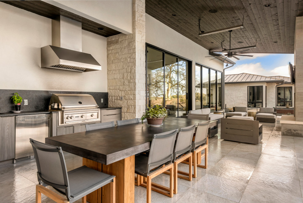 Inspiration for a contemporary tile patio kitchen remodel in Austin with a roof extension