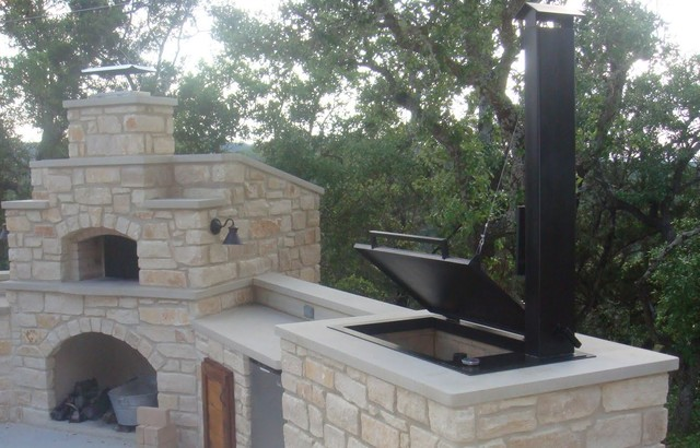 Hill country outdoor kitchen features smoker and pizza for Country outdoor kitchen