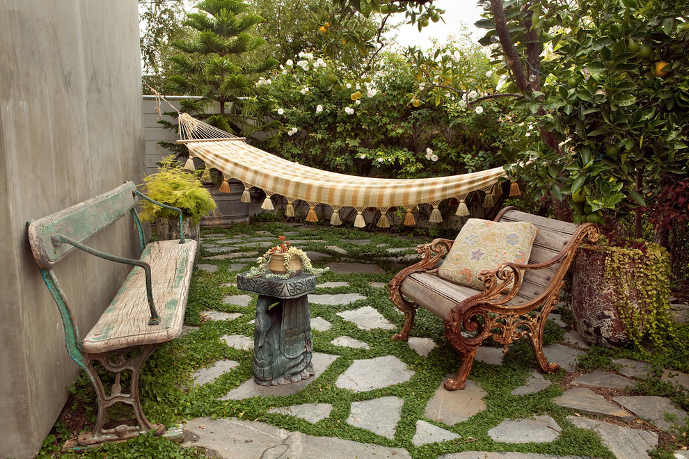 Mid-sized eclectic backyard stone patio photo in Los Angeles with no cover