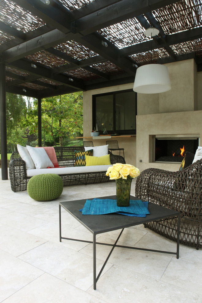 Huge trendy tile patio photo in Los Angeles with a gazebo and a fire pit