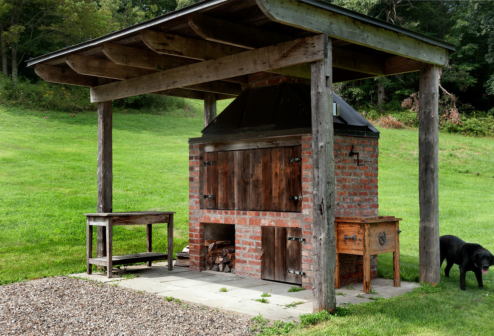 Patio - farmhouse backyard patio idea in New York with a fire pit