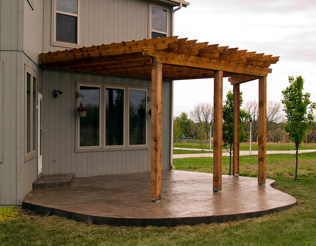 Inspiration for a timeless patio remodel in Kansas City - House - Cedar Pergola With Stamped Concrete Patio. - Traditional