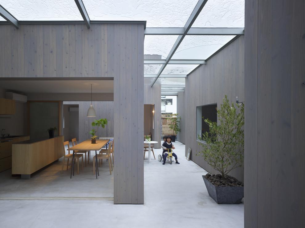 Patio kitchen - contemporary concrete patio kitchen idea in Other