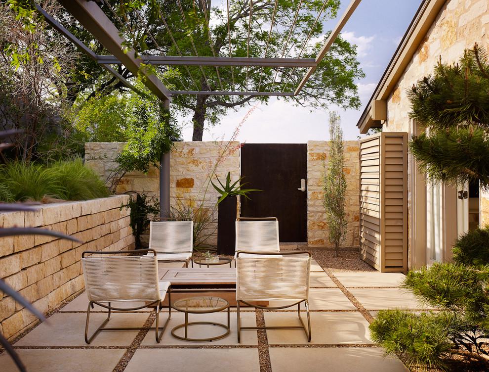 Patio - contemporary patio idea in Austin with a pergola