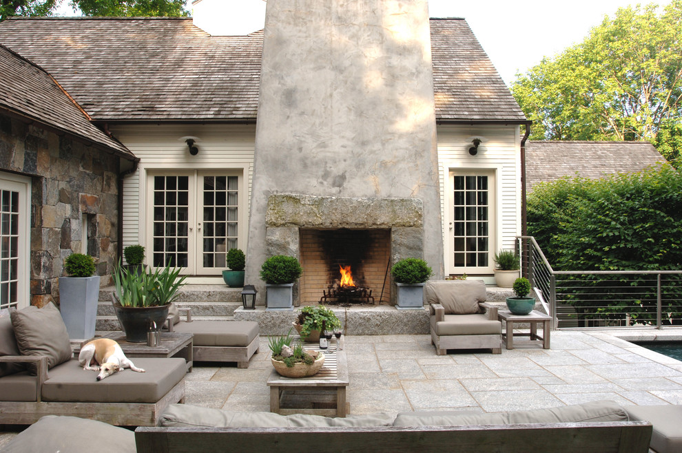 Inspiration for a cottage patio remodel in New York with a fire pit