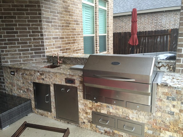 Houston Outdoor Kitchen With Memphis Wood Fire Grill And Scabos Split Face Stone Rustic