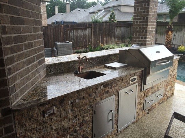 Houston Outdoor Kitchen With Traeger Grill And Scabos Split Face Stone Rust