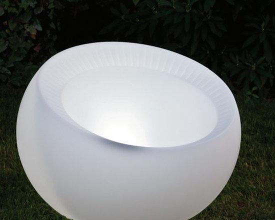 Illuminated Indoor-Outdoor Planter - Illuminated indoor-outdoor planter displays white or rotates through several colors.