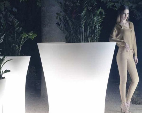 Illuminated Outdoor Planter - The Bones planters have an oval shaped design with a molded planting basin in both the narrow or flared end of the planter allowing you two design options.