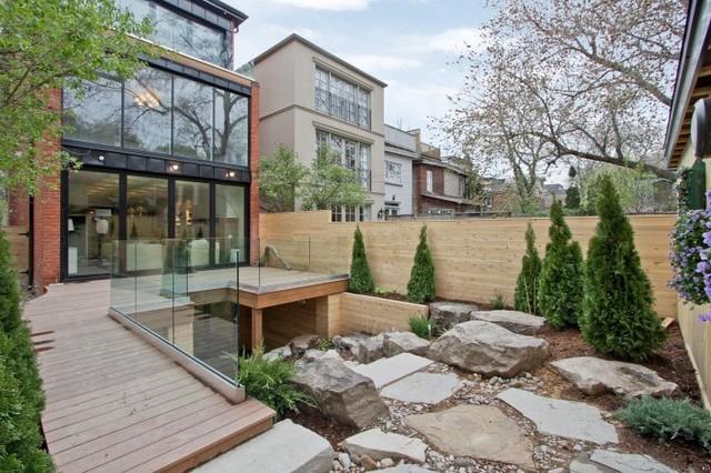 Interior / Exterior Folding Glass Walls modern-patio