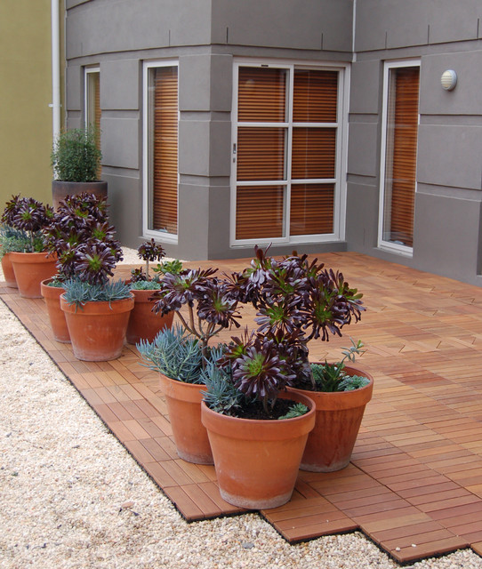 Ipe Wood Deck Tiles Laid Over Gravel For An Instant Patio Contemporary Patio