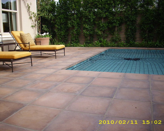 Irvine Model Homes - Roman Tiles used as both field tile and pool coping.  Spanish Cotto is the color blend
