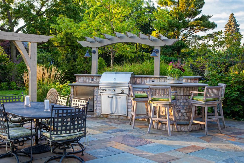 Elegant patio kitchen photo in Chicago