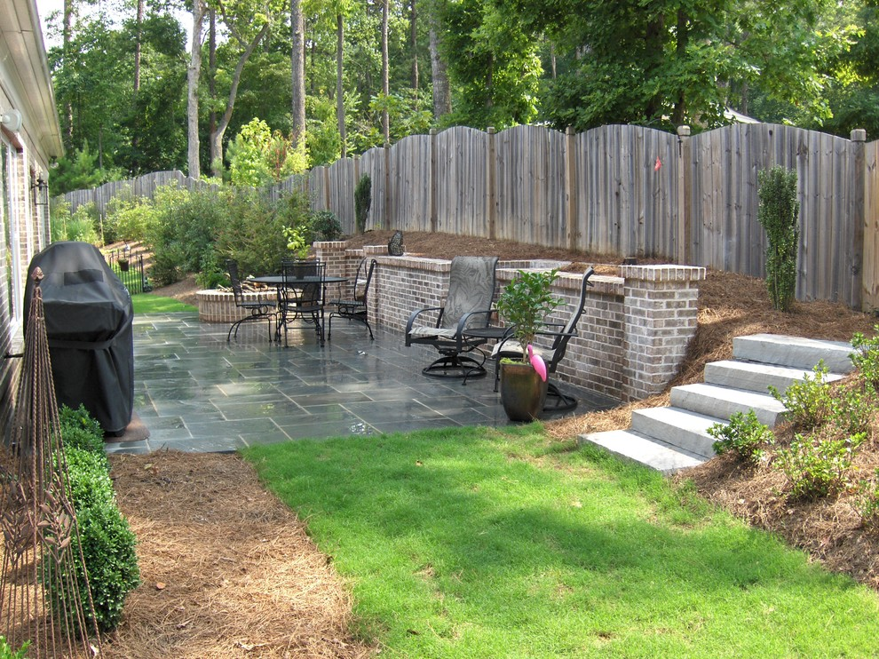 Inspiration for a large timeless backyard tile patio remodel in Atlanta with a fire pit