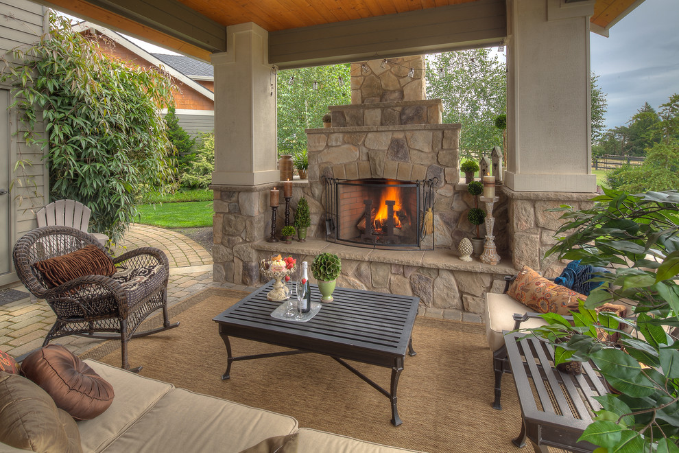 Inspiration for a timeless patio remodel in Portland with a fire pit and a pergola