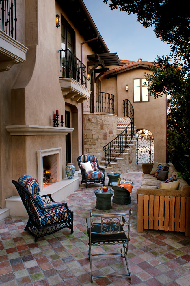 Patio - mediterranean concrete paver patio idea in Los Angeles with no cover and a fireplace