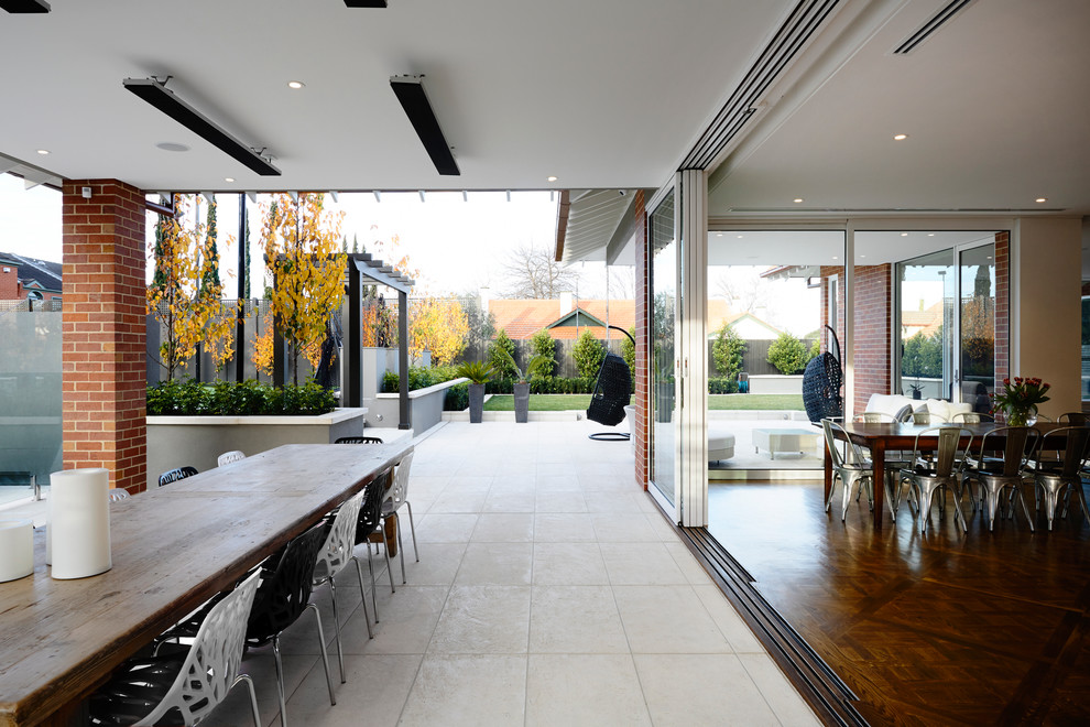 Contemporary patio in Melbourne with a pergola.