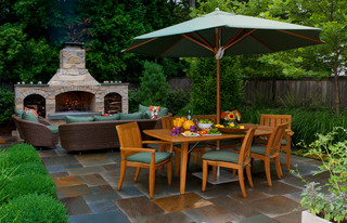 Outdoor dining room with fireplace.