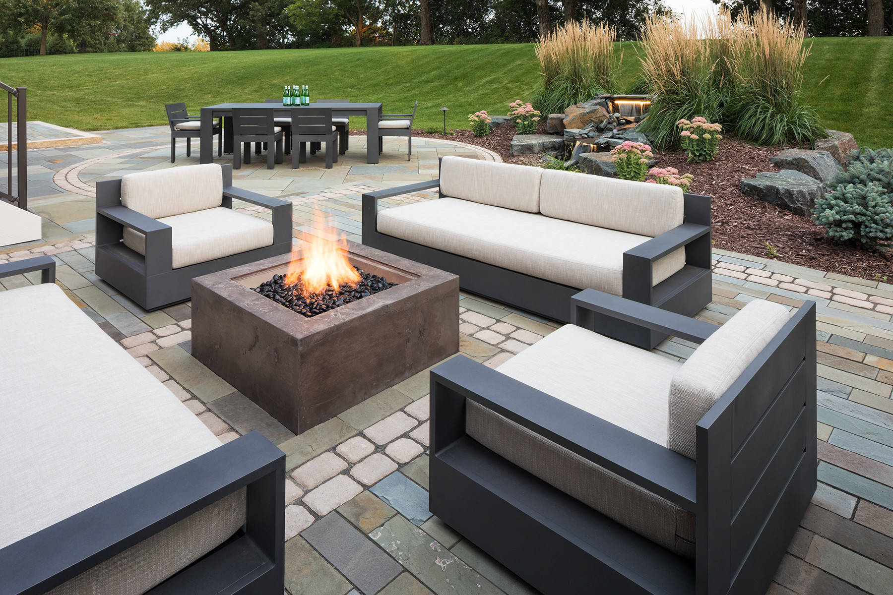 75 Beautiful Concrete Paver Patio With A Fire Pit Pictures Ideas March 2021 Houzz