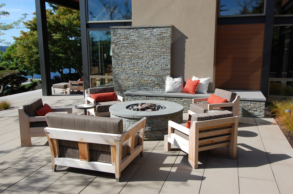 Example of a trendy patio design in Seattle with a fire pit