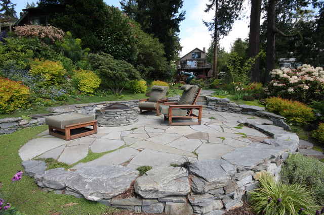 Inspiration For A Contemporary Stone Patio Remodel In Seattle With A Fire  Pit