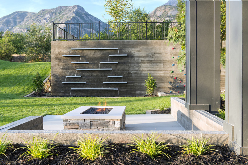 Patio - contemporary patio idea in Salt Lake City with a fire pit