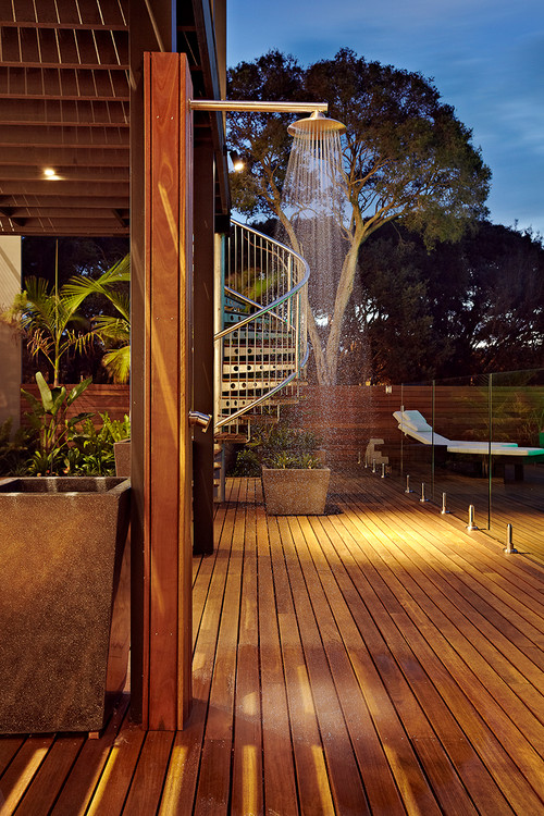 Outdoor shower near pool on timber deck