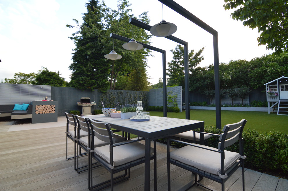 Inspiration for a large contemporary backyard patio remodel in London