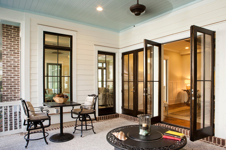 Inspiration for a mid-sized beach style backyard brick patio remodel in Charleston with a roof extension