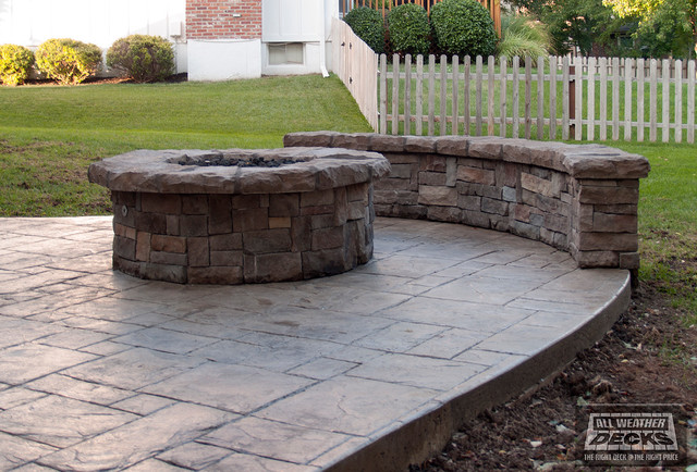 Example of a classic patio design in Kansas City - Leeder - Cedar Deck In Kansas City With Stamped Concrete Patio And