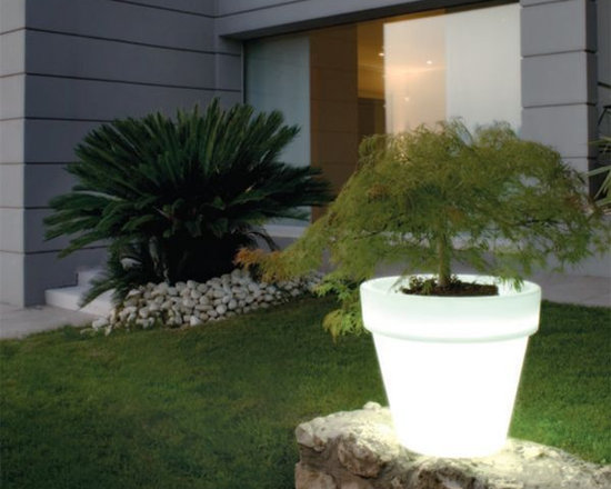 Lighted Outdoor Planter - Lighted outdoor planter displays white or rotates through several colors.
