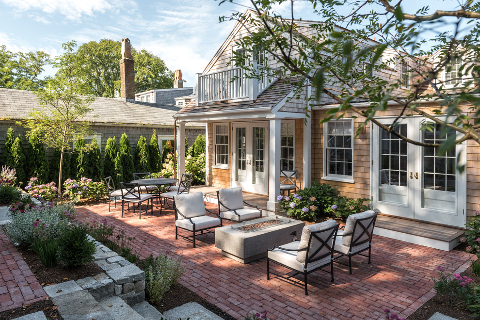 Elegant brick patio photo in Other with no cover
