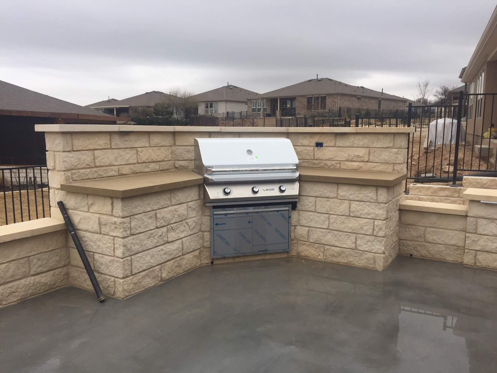 Limestone outdoor kitchen w/ chocolate leuders cap
