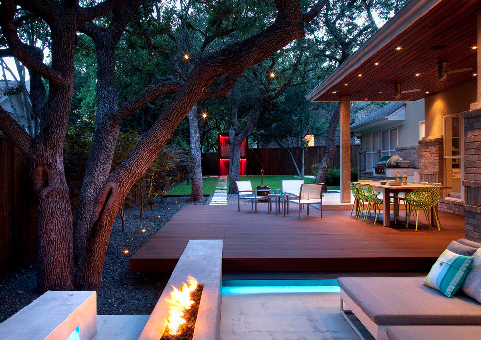 Patio - large contemporary backyard patio idea in Austin with a fire pit and decking