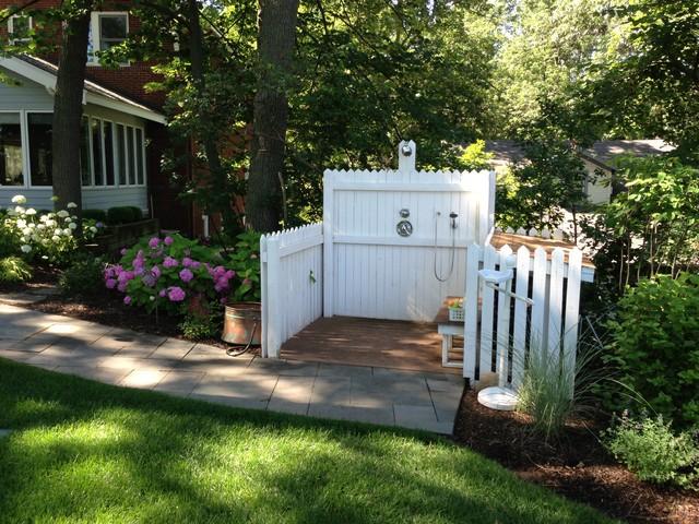 Example of a coastal backyard outdoor patio shower design in Chicago
