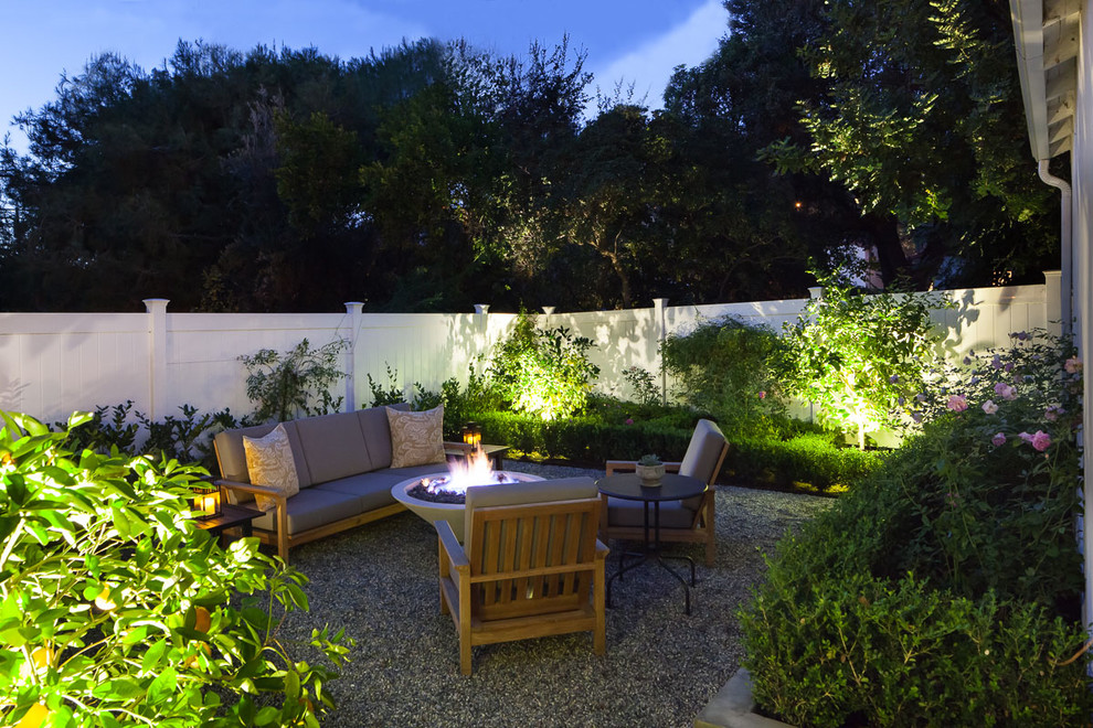 Inspiration for a mid-sized timeless backyard gravel patio remodel in Los Angeles with no cover