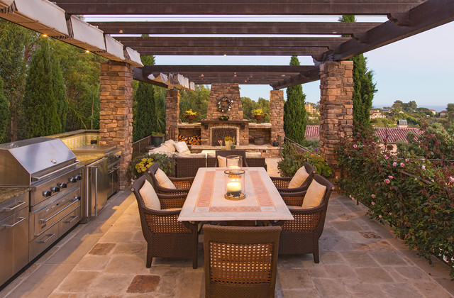 Inspiration for a mediterranean patio kitchen remodel in Los Angeles with a gazebo