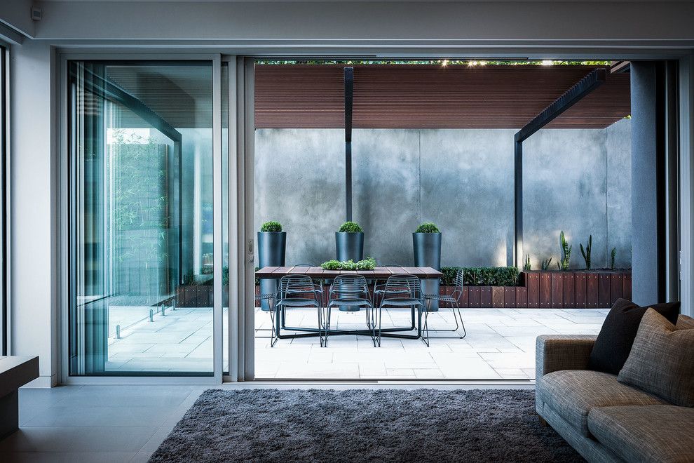 Inspiration for a contemporary courtyard patio in Melbourne with a pergola.