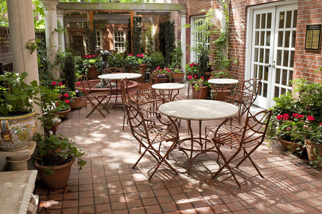 Manhattan Courtyard Garden Design: Mediterranean Patio, Bistro Tables,  Fountain, Traditional Patio