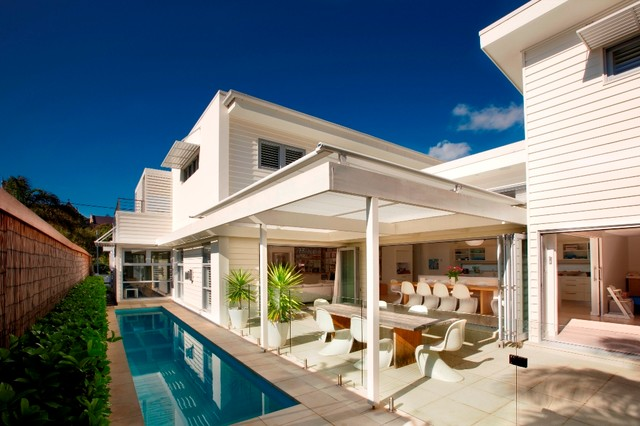 Example Of A Trendy Patio Design In Sydney With A Roof Extension