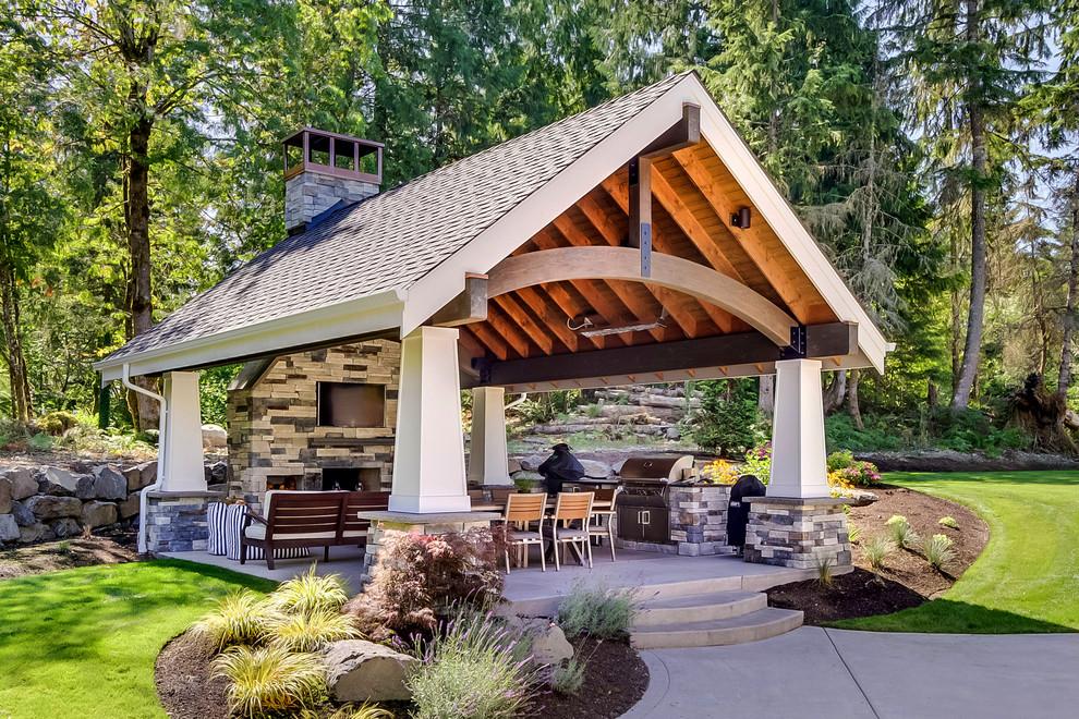 Mid-sized elegant backyard concrete patio kitchen photo in Seattle