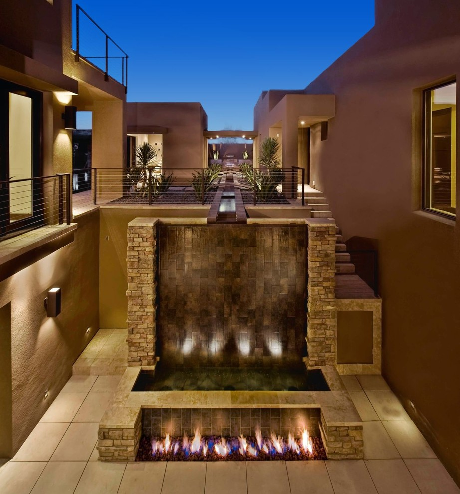 Example of a trendy patio design in Las Vegas with a fire pit