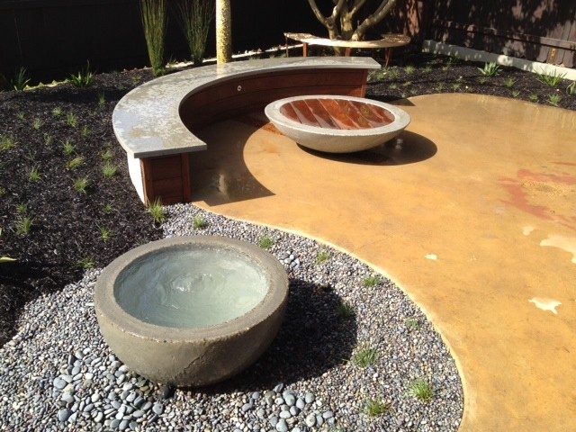 Mid-sized minimalist backyard concrete patio fountain photo in San Luis Obispo with no cover