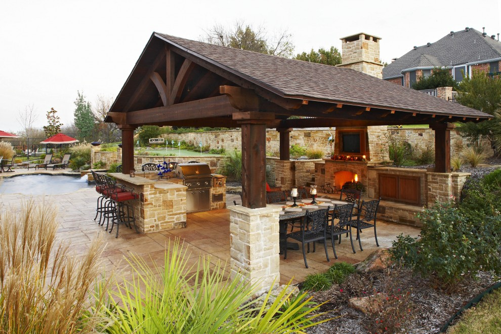 Patio - traditional patio idea in Dallas with a fire pit and a gazebo