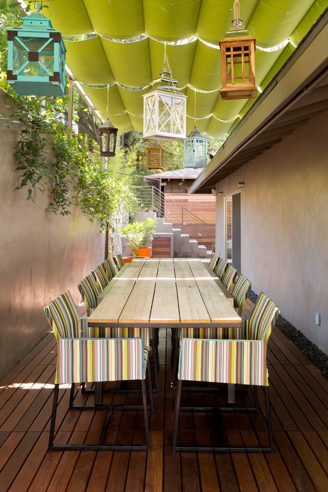 Example of a trendy patio design in Los Angeles with decking and an awning