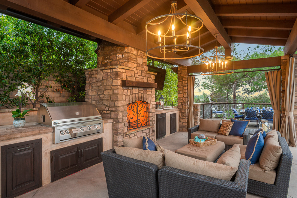 Mid-sized tuscan backyard patio photo in Los Angeles with a gazebo and a fireplace