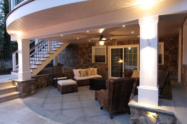 Mediterranean outdoor living madison nj for Outdoor kitchen under deck