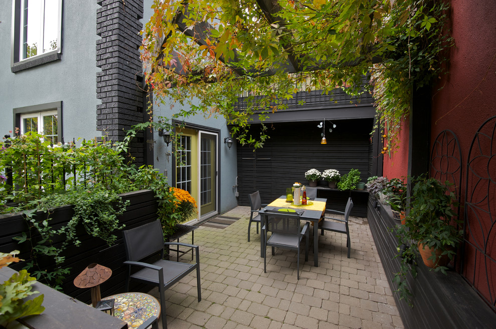 Patio - contemporary concrete paver patio idea in Toronto with no cover