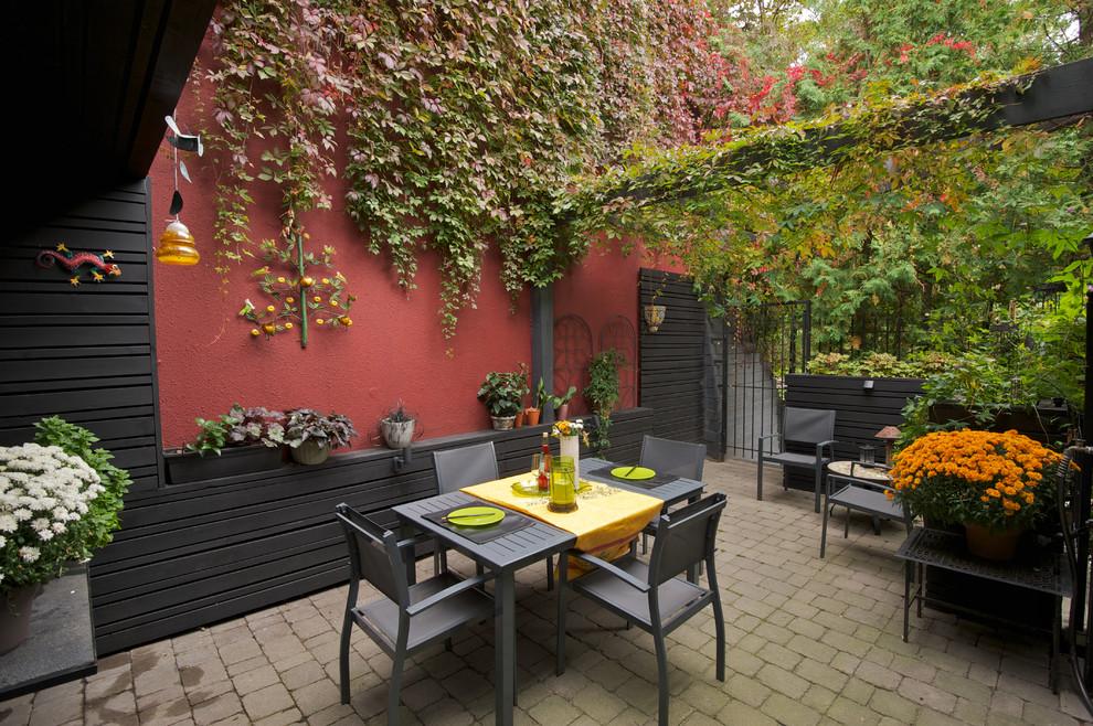 Trendy patio photo in Toronto with a pergola